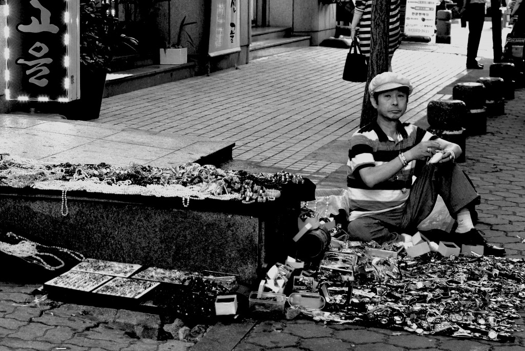 Old watches and beads seller in  a Seoul Street
